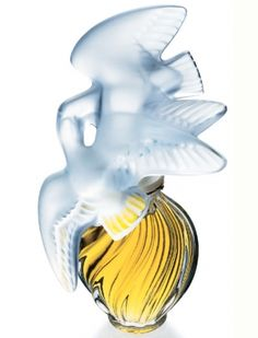 Nina Ricci - L'Air du Temps by Lalique.  L'air Du Temps Perfume by Nina Ricci, Launched by the design house of nina ricci in 1948, l\'air du temps is classified as a refined, flowery fragrance. This feminine scent possesses a blend of gardenia, musk, rose, carnation and sandalwood. It is recommended for evening wear.