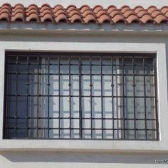 Modelo de herrería reforzada contemporanea de ventanas modernas fabricadas con rejas de hierro