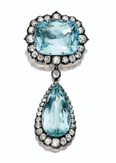 AQUAMARINE AND DIAMOND PENDANT-BROOCH, CIRCA 1880 - Photo  Sothebys The cushion-shaped aquamarine supporting a pear-shaped aquamarine pendant, weighing approximately 44.00 carats and 12.00 carats respectively, bordered by 48 old-mine and old European-cut diamonds weighing approximately 9.00 carats, mounted in silver and gold, brooch fitting and pendant detachable.