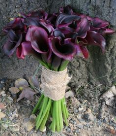 mini calla lily bouquet . . . but i'd wrap it with twine instead of burlap.