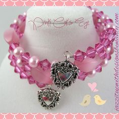 Pink pearls and pink crystals in a beautiful stack bracelet with heart dangles