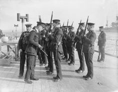MINISTRY INFORMATION FIRST WORLD WAR OFFICIAL COLLECTION (Q 18049)   Officer of the Royal Marines inspecting rifles on board a British Battleship,WW I