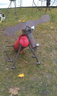 Dog Recycle Garden Sculpture. $55.00, via Etsy.