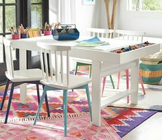 Pottery Barn art play table. I love the storage on the sides and the paper roll holder under the table. The chairs are cute too.