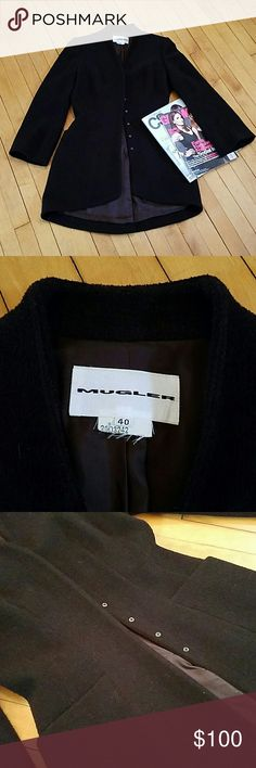 """Mugler Wool Riding Jacket Designer Thierry Mugler Wool blend riding jacket with signature snap closures. 2 front pockets, vent in back. Slightly bell sleeves. Signature cosetted silhouette. Nylon lining. Size 40.  Measurements  18"""" from arm pit to arm pit 23"""" Sleeves 32"""" from shoulder to front hem, 36"""" from neck to hem in back.  Excellent used condition. Mugler Jackets & Coats"""