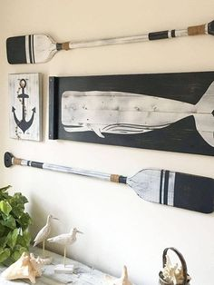 This is a large scale SET OF FOUR nautical art pieces - an anchor, a whale, and two oars with jute rope accents for a truly nautical effect! Hung as shown, the set covers an area 50 wide and 30 tall! Rustic beach house decor is perfect for a nursery, bedroom, bathroom, beach house or anywhere a little fun is needed! And, you can choose your own color scheme! All pieces are painted and then distressed using our custom techniques to create a true vintage nautical effect! - The whale is on a 36...