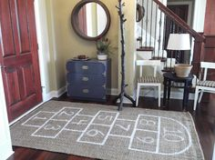 For the kid in us... a diy hopscotch rug! keep beanbag markers in a nearby bowl. :)