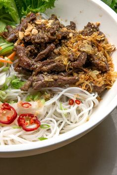 NYT Cooking: Bun Bo Xao, a zesty stir-fry of marinated beef hot from the wok paired with room temperature rice noodles, makes a satisfying main-course salad year-round. Dressed with a classic Vietnamese dipping sauce and topped with roasted peanuts, the flavors are clean, bright and restorative. Yes, this recipe calls for a lot of ingredients, but the prep is simple, and it's an easy%2...