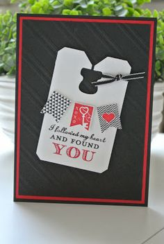 "The translation is a little rough, but the card itself is fantastic!  A punched ""ticket"" with a row of flags and the pop of a 3-D heart will make a handmade valentine's card.  Love the use of red, black and white."