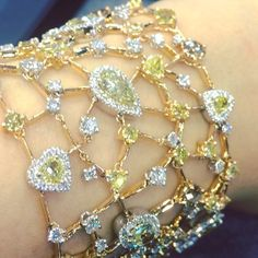 "@massimoraiteri ""Soft Galaxy"" multi shaped and multi coloured diamond bracelet, definitely one of my favourites back in #SingaporeInternationalJewelryExpo! Experience #SIJE2015 through my eyes by checking the latest blog post link in bio! #ClassicChapter #OvalObsession #CushionCrush #PearShaped #YellowLovin #MarquiseMadness #RoundBrilliant #HeartShaped #OvalCut #MarquiseCut #CushionCut #Brilliance #Scintillation #Sparkle #Fire #ChampagneGem"