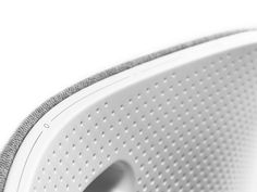 BeoPlay A6 by B&O | an interesting juxtaposition of materials from B&O on this wireless speaker. The fine textured plastic body gives a subtle, satin look finish to the product.  It makes you want to touch and caress it, caisdesign.com