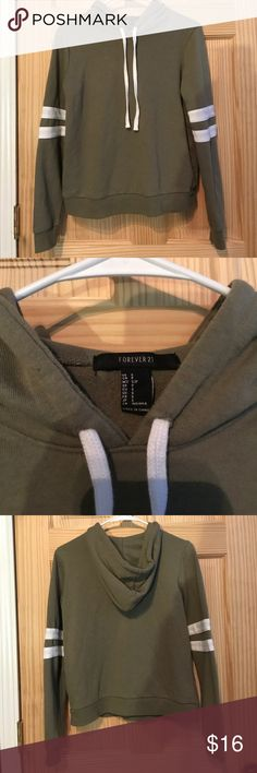 Forever 21 Hoodie Forever 21 olive green hoodie. Stylish street wear, similar to adidas. Cozy mid-length hoodie great with mid-rise jeans or leggings! Great condition Forever 21 Tops Sweatshirts & Hoodies