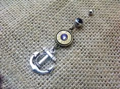 Bullet belly button ring with silver tone anchor charm #nautical #guns #anchor