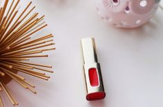 what's trending!}  A great review on the L'Oreal Colour Riche Extraordinaire lip color in the shade Orange Tempo.