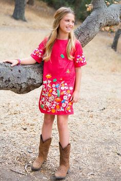 Capture the feeling of spring with butterflies flitting through a poppy-filled garden alive with vibrant colors and enchanting embroidery on this eye-catching dress designed by Stella McCartney kids. Pairs well with our Sidewinder Boots (pictured here and sold separately) Detailed embroidery on front and sleeves Comfortable half length sleeves and relaxed fit