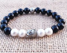 Check out this item in my Etsy shop https://www.etsy.com/uk/listing/286025539/pearl-bracelet-buddha-zen-pearl-bracelet