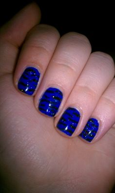 Blue and black zebra nail design