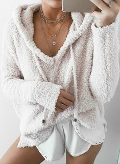 The navy color sweatshirt is featuring drawstring hood, long sleeve, pullover style, christmas deer print.