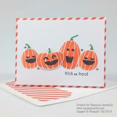 handmade Halloween card ... clean and simple ... laughing pumpkins ... luv the diagonally striped paper as mat and envelope liner ...