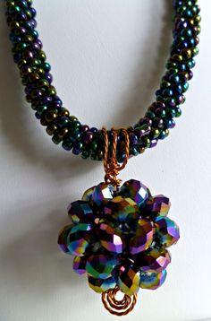 "Beaded kumihimo necklace - rainbow blue iris with blue iris beaded ""disco"" ball bead ""Disco Fever"" by TheBeckoningCat on Etsy https://www.etsy.com/listing/91168518/beaded-kumihimo-necklace-rainbow-blue"