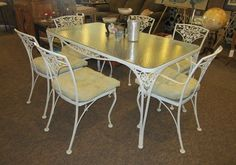 "WROUGHT IRON GLASS TOP TABLE WITH 6 CHAIRS - Great table for indoor or outdoor.  It has been well cared for.  The table is 23"" by 60""."