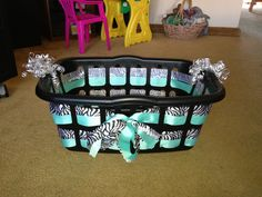 Cute way to decorate the basket! Fill it with stuff for a cute baby shower gift!!