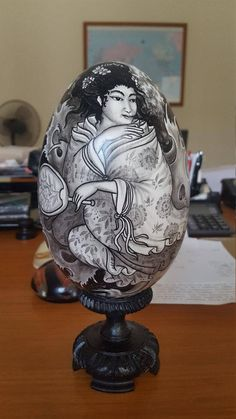 A superb piece of art painted on this imitation ostrich egg made of wood. The design is painted with a piece of bamboo, no brush is used! And is so intricate and attention to detail its an amazing fete painted by Wayan Ana a famous artisan in Bali, Indonesia. Who is the third generation