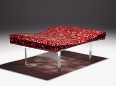 Designs featuring organic materials and found objects blur the lines between furniture and art