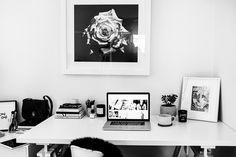 Fashion blogger Talisa Sutton's monochromatic, minimalist desk complete with notebooks, candles, Tovl artwork, and black sheepskin.