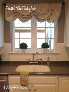 Go ahead and paint your ceramic tile kitchen backsplash if you're thinking about doing it. A year and a half later, mine is still in perfect shape. It's a quick, easy, and inexpensive way to update your kitchen. How-to's are included in the post.