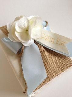 "Rustic baby photo album, premium white hydrangeas, burlap, light blue ribbon and rope bow, hand stamped ""Cutie Pie"" banner"