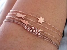 Rose gold, thin chains, & cool charms. I like!