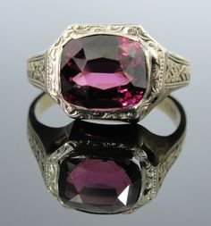 Hey, I found this really awesome Etsy listing at http://www.etsy.com/listing/124851882/art-deco-rhodolite-garnet-ring-green-and