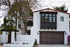 Customized wood garage door & gate design in an authentic spanish colonial style - mediterranean - exterior - san francisco - by dynamic garage door