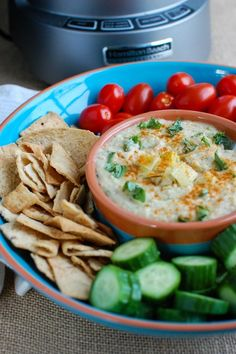 White Bean Artichoke Dip is a healthy appetizer, snack or spread for sandwiches. White beans, artichokes, lemon juice, olive oil, cayenne pepper, basil and garlic are blended and topped with fresh basil and parsley to create a healthy, flavorful dip.// A Cedar Spoon