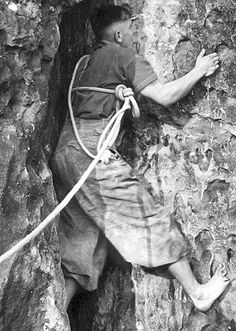 A true toehold! This is Moni's dad climbing in the Elbsandstein some time in the mid 1930's. Note the massive rope and how they used to tie in. No such thing as a sit-harness. The really hard stuff was often climbed barefoot.   Photographer unknown.