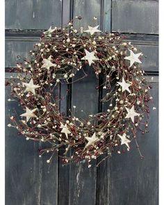 Une couronne de Noël naturelle à fabriquer avec des branchages. Simple et pas cher !