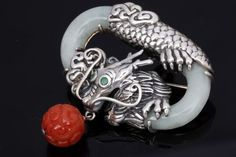 Modern, but appealing, Chinese export silver and jade dragon brooch/pendant.
