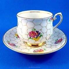 Pretty Hand Painted Floral Phoenix Tea Cup and Saucer Set