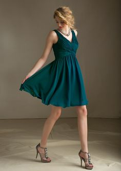 Color of the bridesmaid dresses-- teal. AFFAIRS By Mori Lee