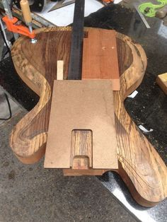 Build a gorgeous solid body electric guitar from scratch with mostly hand tools.