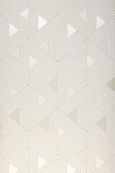 This geometric wallpaper with triangular shapes in silver will delight you. Fantastic shimmer effects attract the eye and add to the sense of value of this premium-quality non-woven wallpaper. In cream-white and grey-beige, it exudes luxury and elegance.