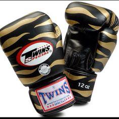 Twins Tiger Boxing Gloves in black and gold - cat fight, anyone?