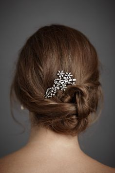 This is a hairpin from bhldn, but this look can be achieved with a vintage brooch.