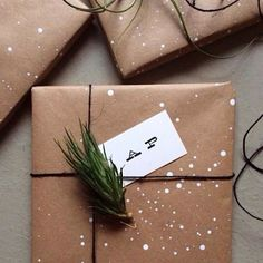 snow flakes with white paint drops on kraft paper