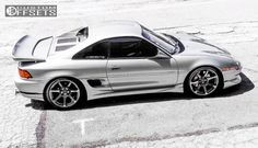 32201-5-1991-mr2-toyota-lowered-adj-coil-overs-cosmis-racing-mr7-chrome-slightly-aggressive.jpg (1000×573)
