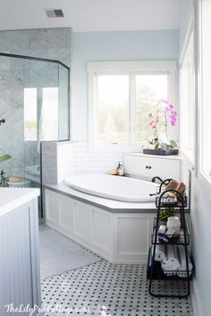 I love the idea of the little cupboard behind the tub to hide the soaps and wash stuff. Keeps such a clean look