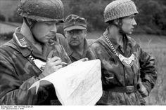 Normandy , German Feldgendarme (military police) and a paratrooper. France 1944