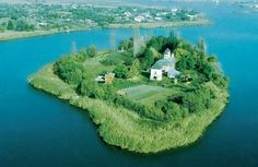 Lake Snagov in Rumania with the island monastery in the center.