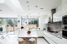 © All photographs by David ButlerEye-opener: the use of roof lights and of white and translucent chrome furniture make the kitchen/dining room seem huge (garden lighting plan side return) Living Room Kitchen, New Kitchen, Kitchen Interior, Kitchen Decor, Dining Room, Open Plan Kitchen Dining Living, Awesome Kitchen, Kitchen Sink, Kitchen Island